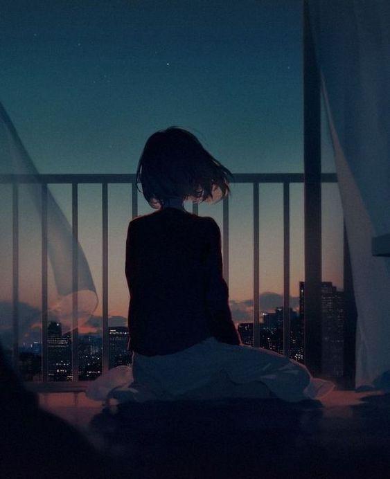 Hình ảnh cô gái ngồi một mình cô đơn ngắm nhìn mọi thứ qua cửa