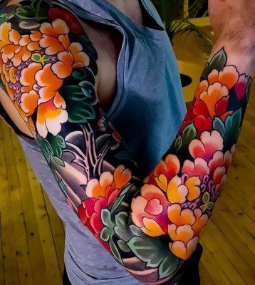 Kiểu xăm hoa mẫu đơn bít tay với màu sắc rõ nét