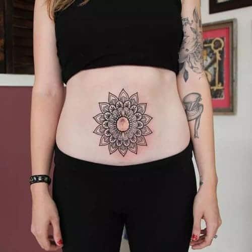 hình tattoo hoa văng ở bụng nữ