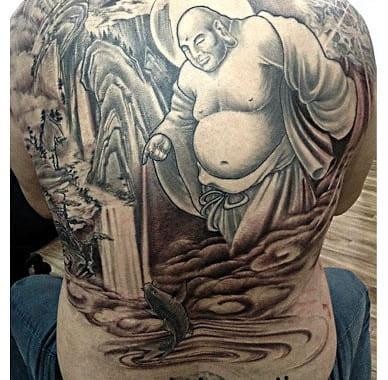 hình tattoo phật di lặc điểm hóa cá chép