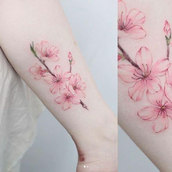 mẫu tattoo nhành hoa dễ thương ở bắp chân cho phái đẹp