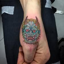 tattoo đầu rồng mini trên ngón tay