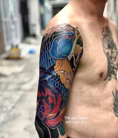 Hình tattoo cá rồng kín tay độc lạ