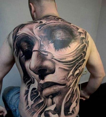 Mẫu tattoo khuôn mặt cô gái kín lưng