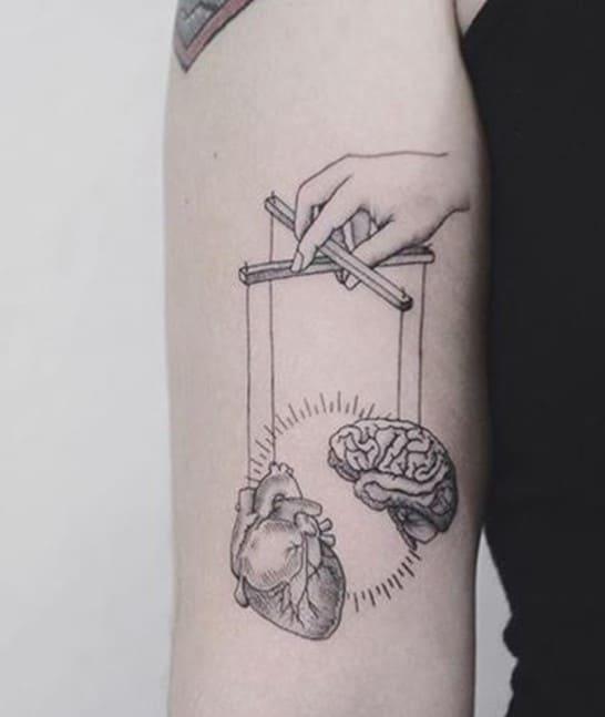 hình tattoo hài hước bá đạo trên cánh tay