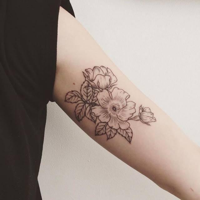 tattoo hình hoa trên bắp tay trong cho phái đẹp